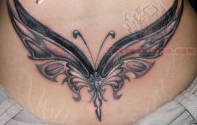 Large Wings Butterfly Tattoo On Lower Back