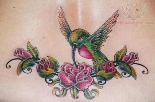Hummingbird And Flower Lowerback Tattoo