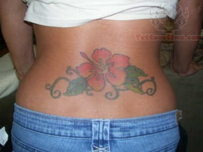 color lily flower lower back tattoo. Black Bedroom Furniture Sets. Home Design Ideas