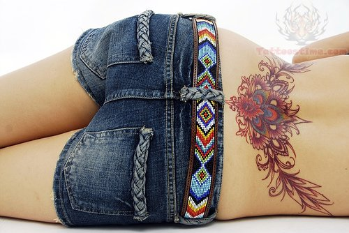 Peacock Feather Lower Back Tattoo