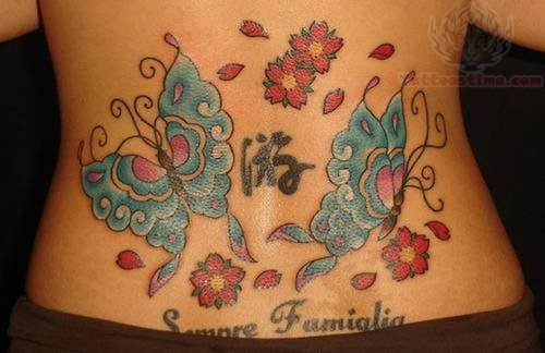 Lower Back Blue Butterflies And Flower Tattoo