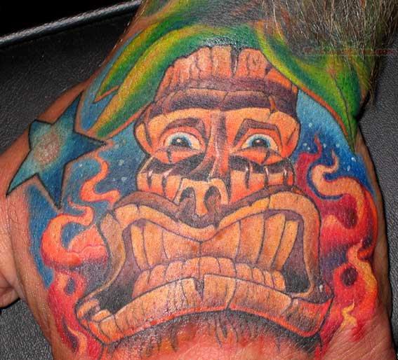 Flaming Tiki Mask Tattoo On Hand