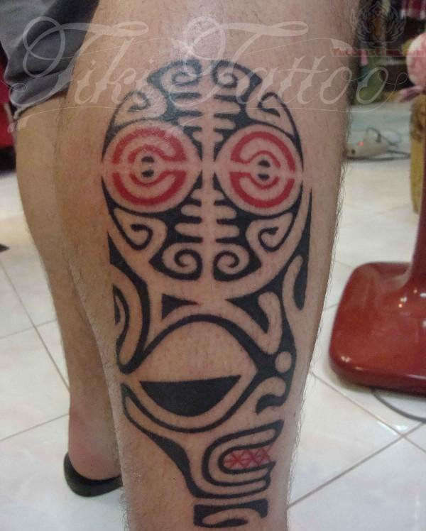 Polynesian tiki tattoo on right leg for Polynesian thigh tattoo