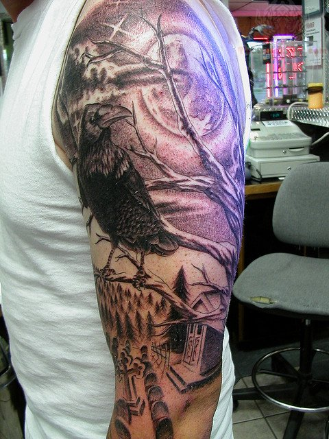 Grey Ink Raven Tattoo On Sleeve