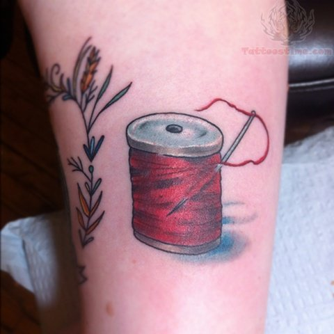 Red Ink Spool Tattoo
