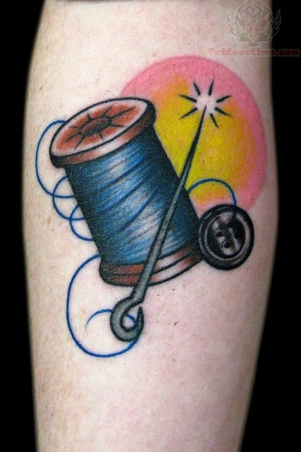 Spool Needle And Button Tattoo On Arm
