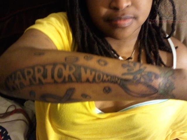 Warrior Woman Spoon Tattoo On Arm