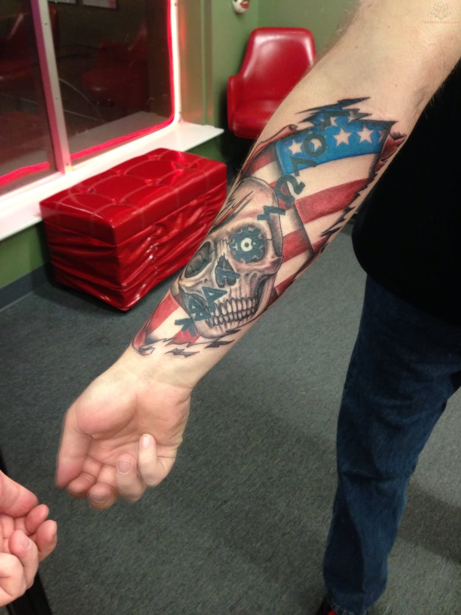 Patriotic Skull And Flag Color Ink Tattoo On Arm