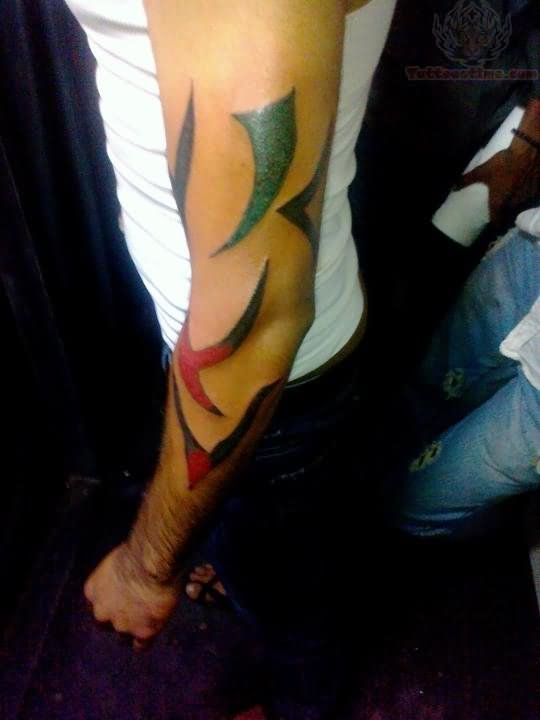 Beautiful Color Ink Tribal Tattoo On Left Arm