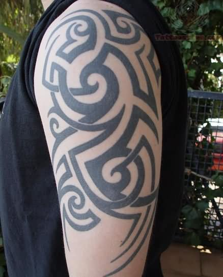 Tribal Tattoo On Left Bicep For Men