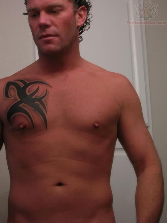 Tribal Tattoo On Men Chest