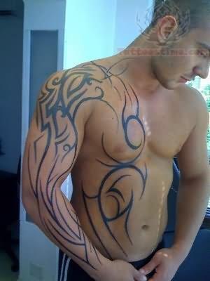Tribal Tattoo On Sleeve And Side Rib