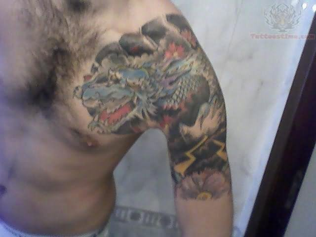 Japanese dragon tattoo on chest and shoulder for Shoulder and chest tattoos