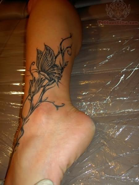 Grey ink butterfly and flower tattoo on ankle