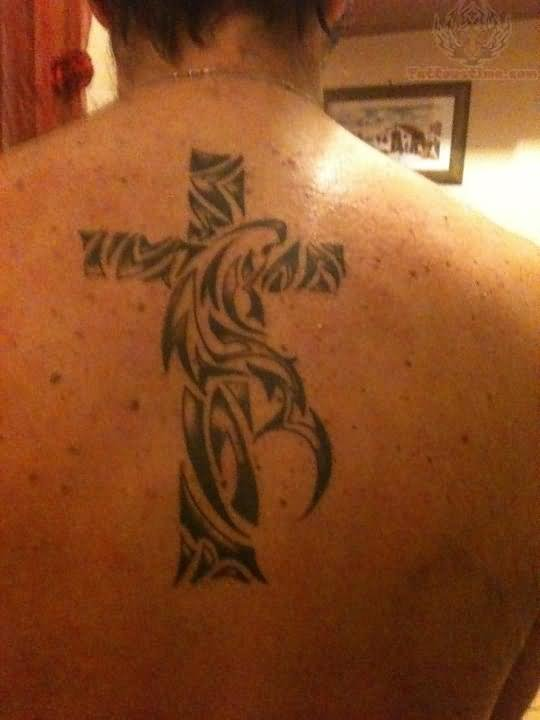 Tribal Cross Tattoo On Men Back