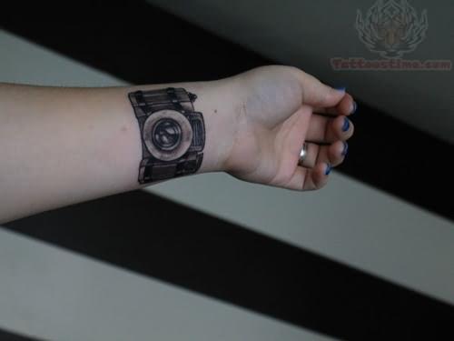 Camera Tattoo On Left Forearm