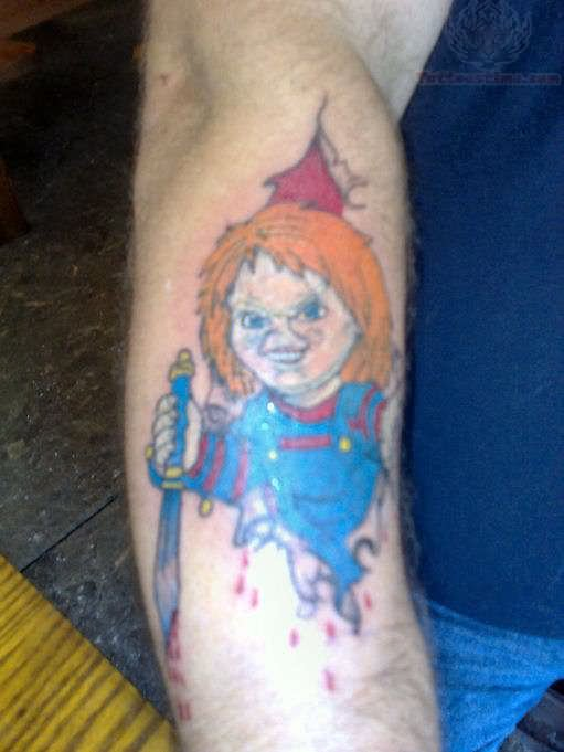 colored chucky tattoo on right sleeve. Black Bedroom Furniture Sets. Home Design Ideas