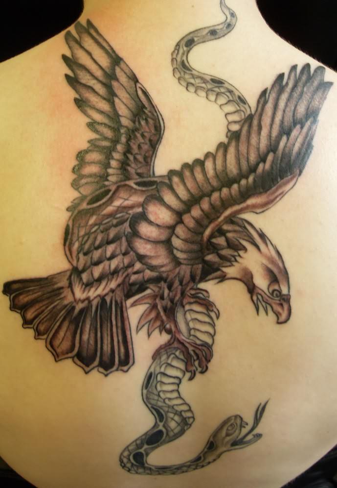 45 most exotic snake tattoos designs. Black Bedroom Furniture Sets. Home Design Ideas