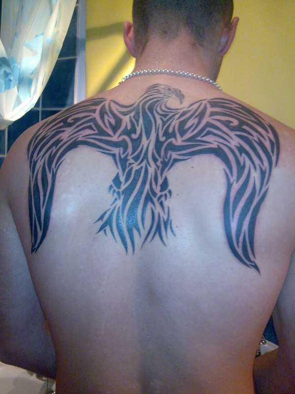 Tribal eagle wings tattoo on back for Eagle wings tattoo
