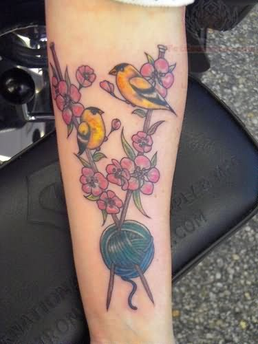 Flowers, Sparrow And Kniiting Tattoo On Arm