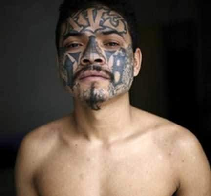 Extreme gang tattoo on face for Gang face tattoos