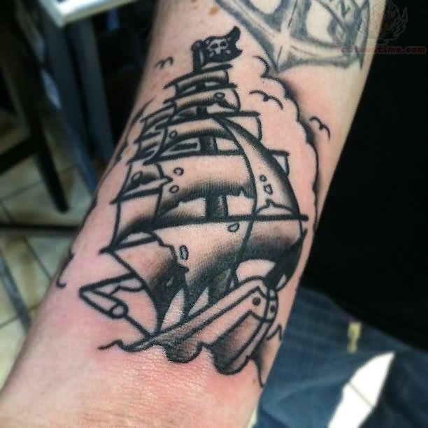 Ship Tattoo Small: Grey Ink Small Pirate Ship Tattoo On Arm