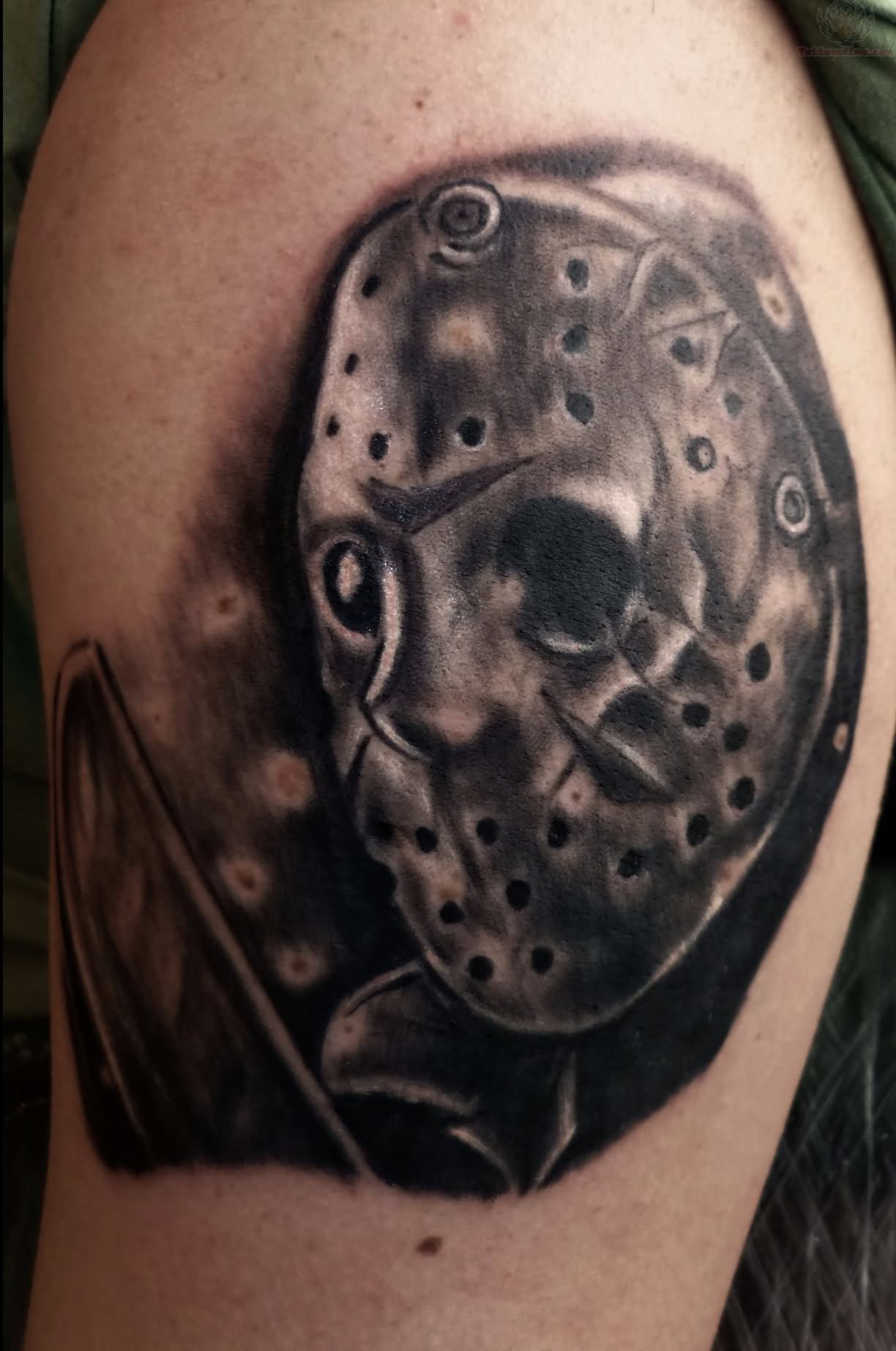 Grey ink freddy and jason tattoo on half sleeve