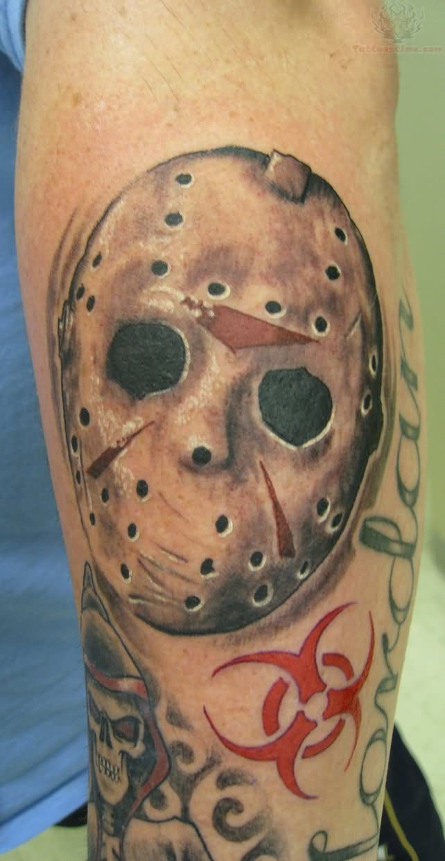 jason vorhees mask tattoo on men left sleeve
