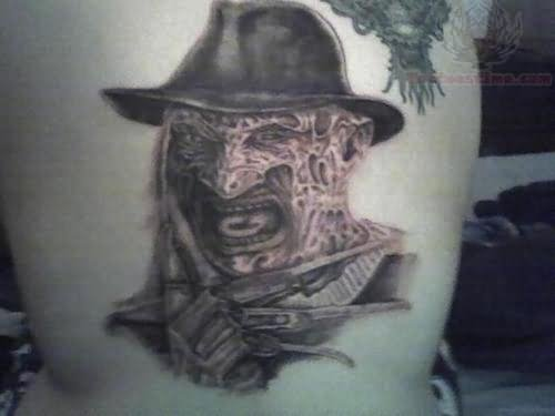 Ripped Skin Freddy Krueger Claw Tattoo