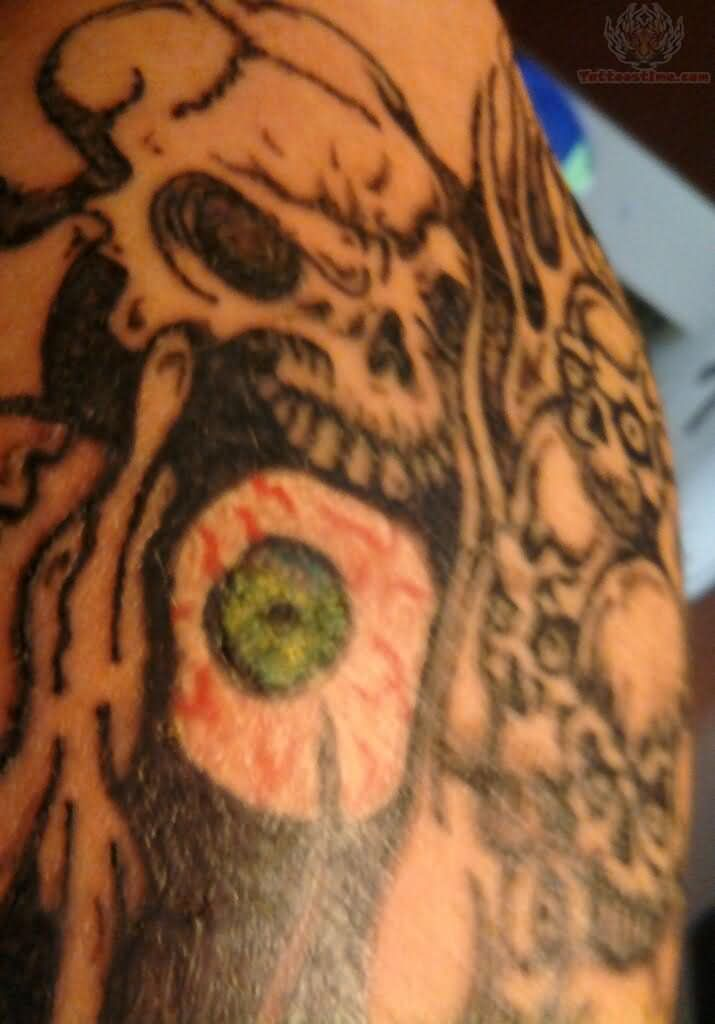 Grey Ink Skull And Green Eye Arm Tattoo