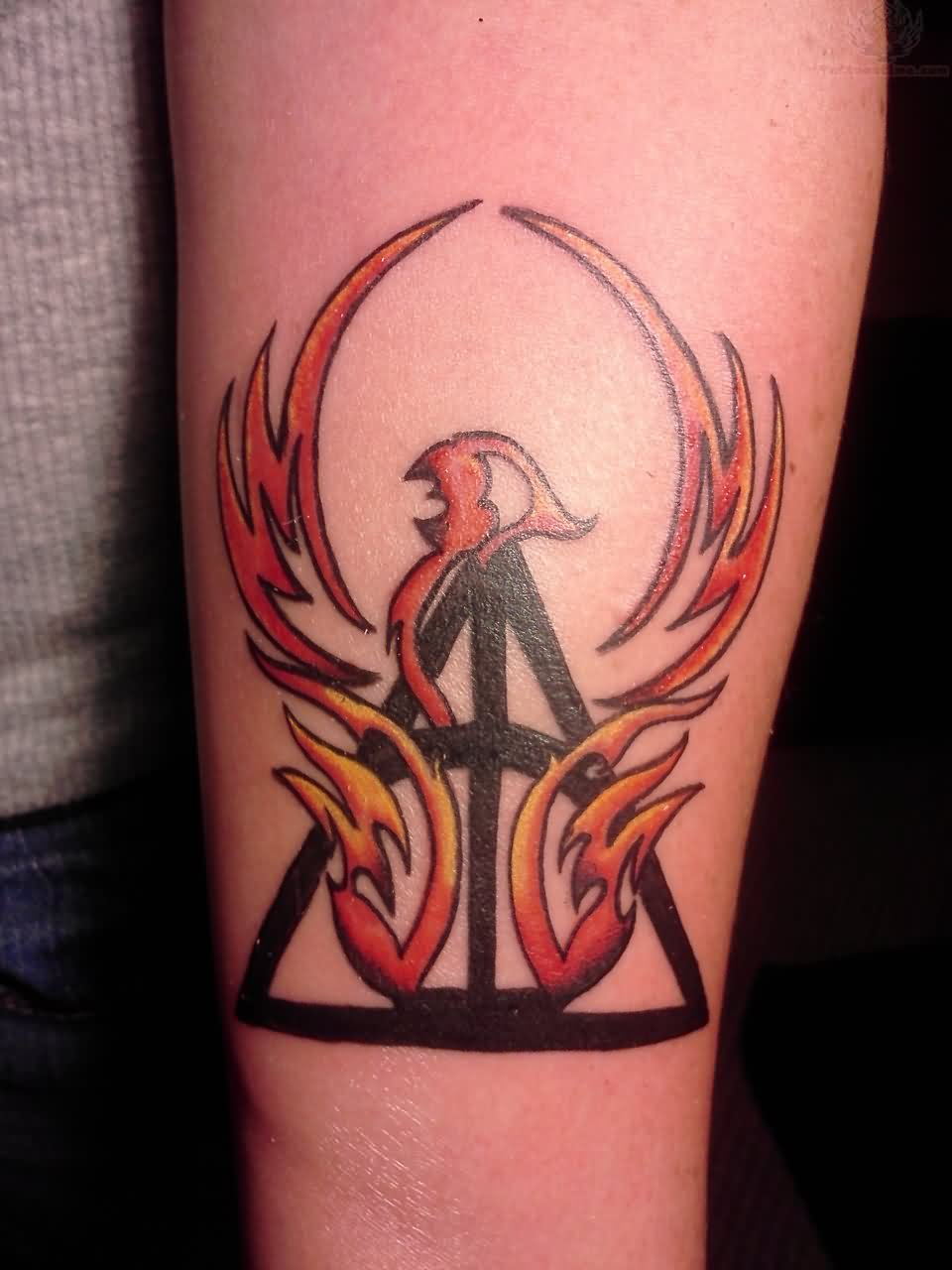 Tribal Color Ink Phoenix Tattoo On Forearm