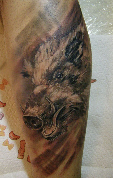 grey ink wild boar head tattoo on leg