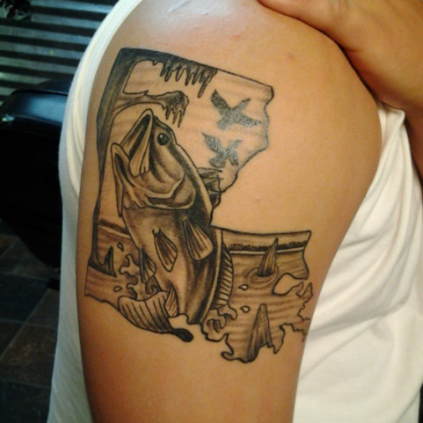 grey ink fish and flying ducks tattoo on right bicep