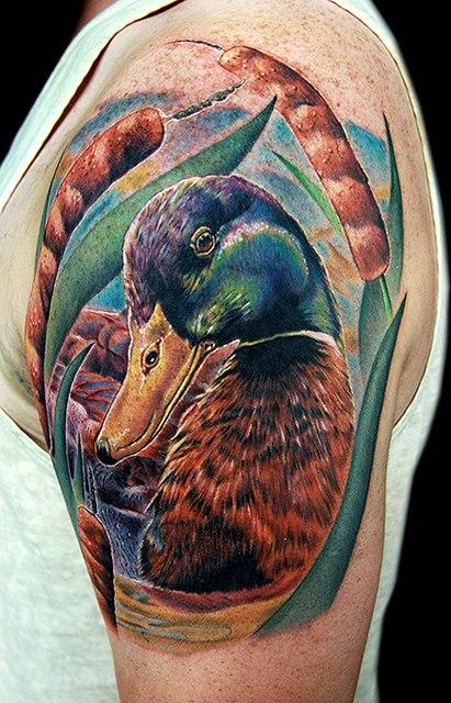 realistic color ink duck head tattoo on left shoulder. Black Bedroom Furniture Sets. Home Design Ideas