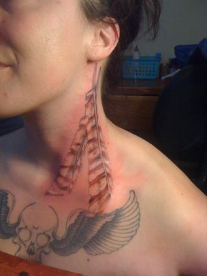 Winged Skull And Hawk Feathers Tattoos On Girl Chest