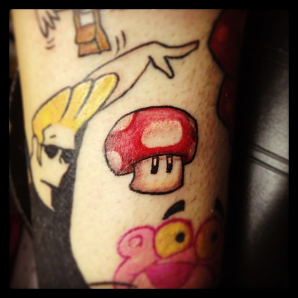 Color ink cartoon and mario mushroom tattoo for Mario mushroom tattoo