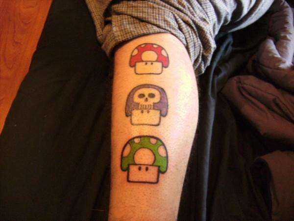 Colored mario mushrooms tattoo on leg for Mario mushroom tattoo