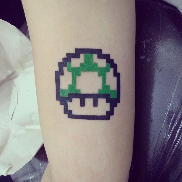Green Mario Mushroom Tattoo