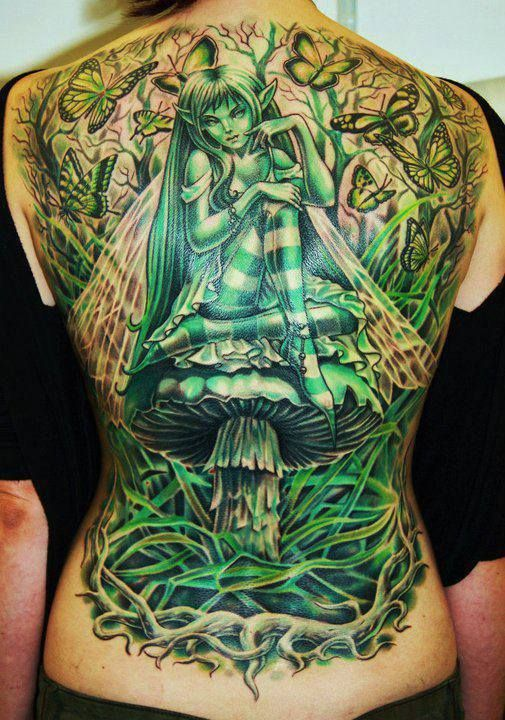 d2a96c021 Green Ink Gothic Fairy And Mushroom Tattoo On Back Body