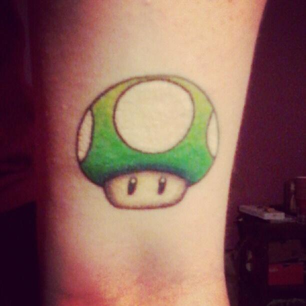 Kingdom Hearts And Mario Mushroom Tattoo On Wrist