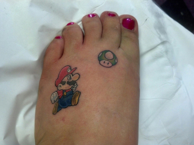 Mario and mushroom tattoo on left foot for Mario mushroom tattoo