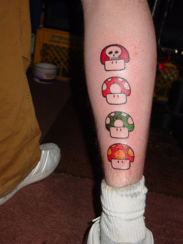 Mario mushrooms colored tattoos on back leg for Mario mushroom tattoo