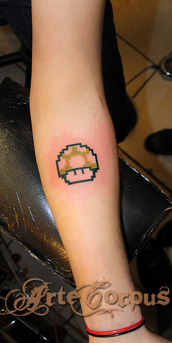 Small mario mushroom tattoo on arm for Mario mushroom tattoo