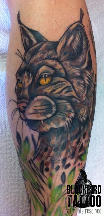 Yellow Eyes Grey Ink Lynx Tattoo