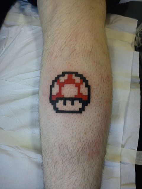 Red Mario Mushroom Tattoo On Arm