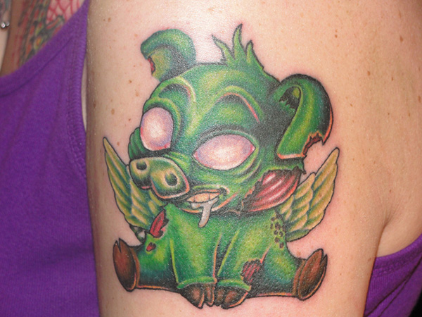 eb489a809 Angel Winged Zombie Pig Green Ink Tattoo On Shoulder