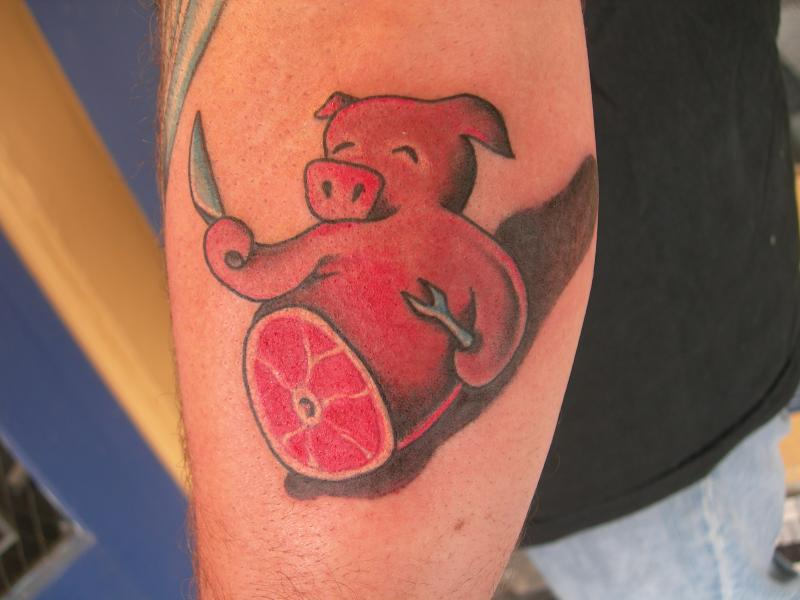 pig with knife and spanner color ink tattoo