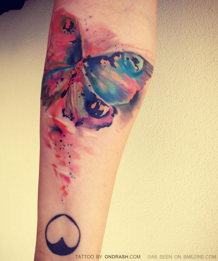 Abstract Color Ink Moth Tattoo On Arm