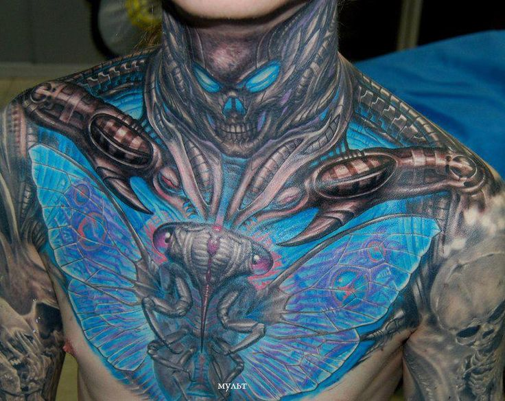 Biomechanical color ink moth tattoo on chest for Color chest tattoos