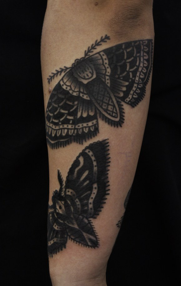 Black ink moth tattoo on sleeve for Black tattoo ink